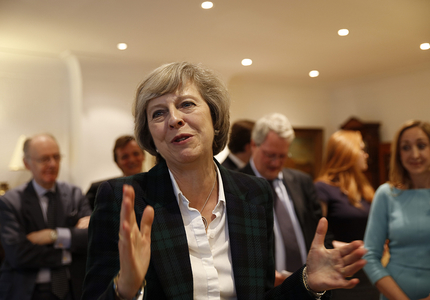 Theresa May la Davos: Marea Britanie va fi după Brexit un lider global al comerţului liber