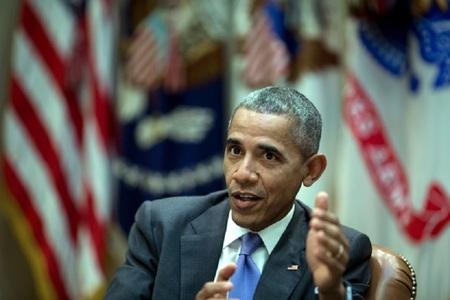 În ultimul mesaj de Anul Nou transmis de la Casa Albă, Obama le-a mulţumit americanilor pentru că au construit o naţiune mai puternică