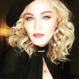 Madonna a negat zvonurile despre adopţie şi a spus că vizita ei în Malawi vizează acţiuni de caritate