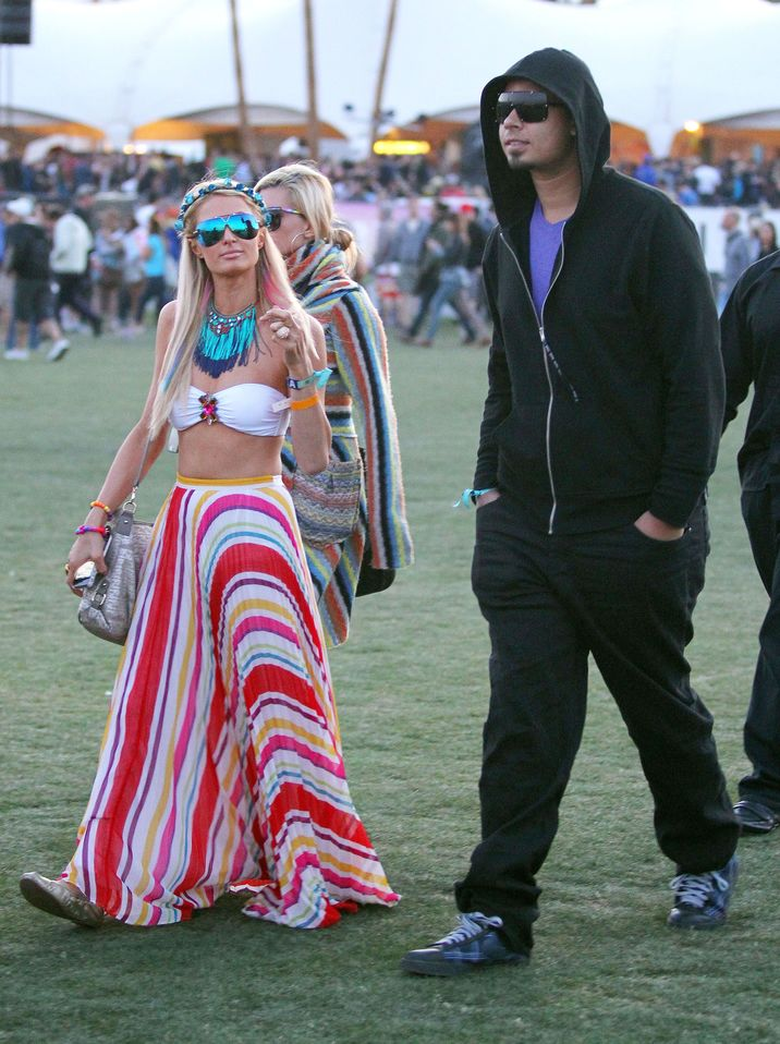 "8986159 Celebrities gallivant around the grass areas of the ""Coachella Music Festival"" on day 2 of the massive event located in the Coachella dessert of California on April 14, 2012. Pictured: Paris Hilton, DJ Afrojack FameFlynet, Inc. - Santa Monica, CA, USA - +1 (818) 307-4813"