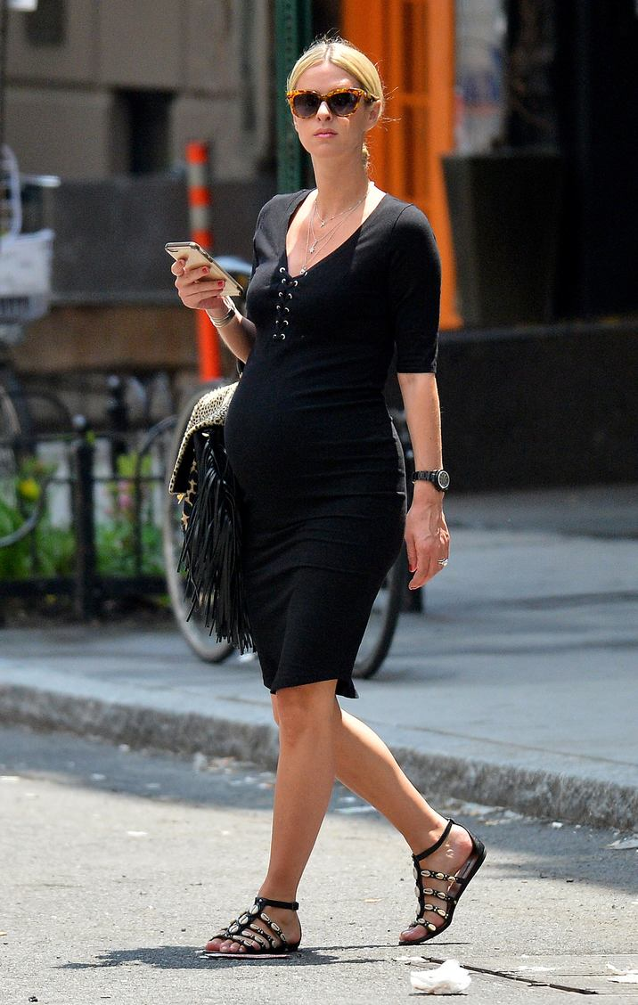 52077899 Pregnant Nicky Hilton was spotted out and about in the Soho District, New York on May 31, 2016. The stylish mom-to-be was wearing a comfortable black dress, sandals and holding a black fringe bag. FameFlynet, Inc - Beverly Hills, CA, USA - +1 (310) 505-9876