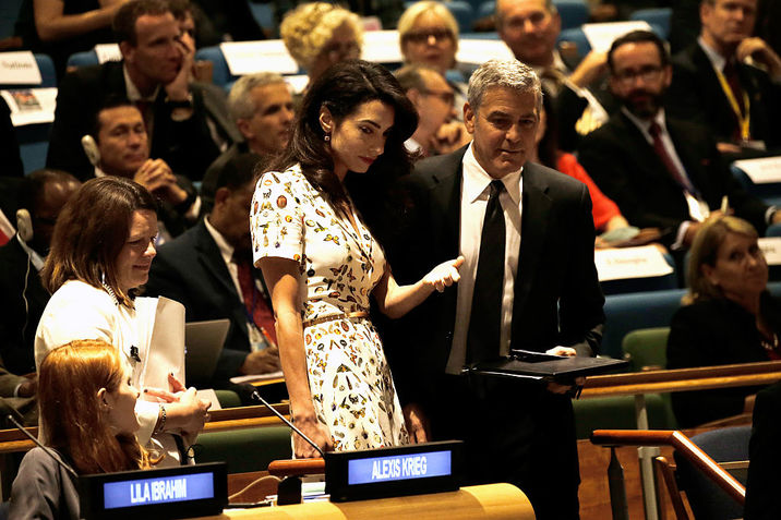 NEW YORK, NY - SEPTEMBER 20:  (AFP OUT) Actor George Clooney (R) and wife, human rights lawyer Amal Clooney, attend a Leaders Summit for Refugees during the United Nations 71st session of the General Debate at the United Nations General Assembly on September 20, 2016 in New York, New York. The general debate of the 71st session will conclude on September 26. (Photo by Peter Foley - Pool/Getty Images)