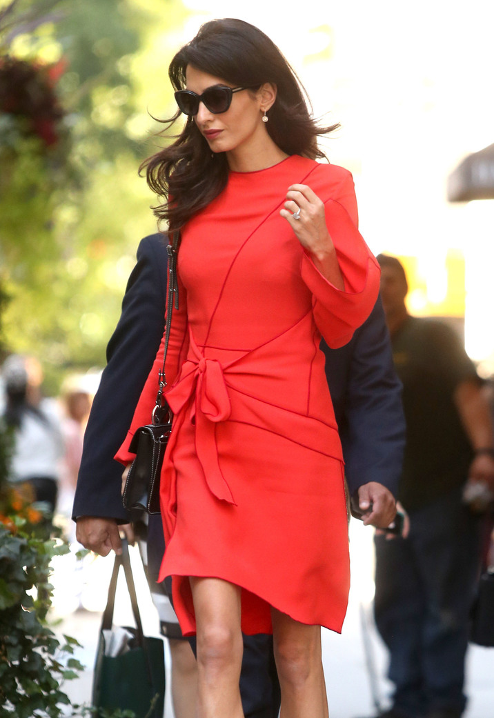 52182700 Layer Amal Clooney steps out wearing a bright pink dress in New York City, New York on September 22, 2016. Amal and her husband, actor George Clooney, will be celebrating their second wedding anniversary on September 27. FameFlynet, Inc - Beverly Hills, CA, USA - +1 (310) 505-9876