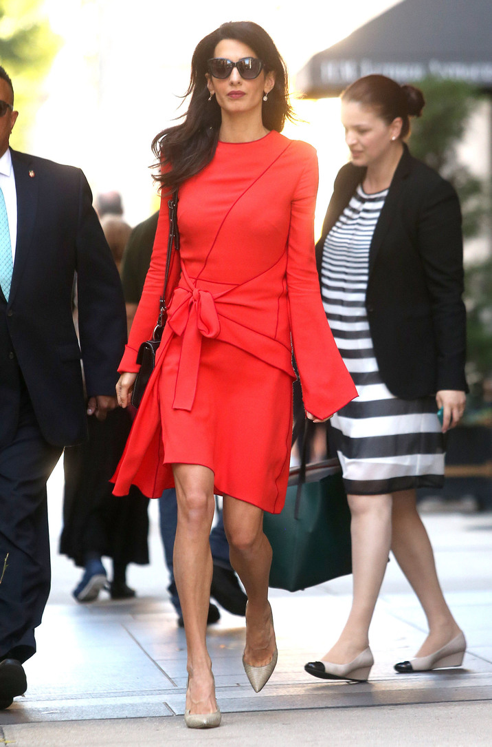 52182695 Layer Amal Clooney steps out wearing a bright pink dress in New York City, New York on September 22, 2016. Amal and her husband, actor George Clooney, will be celebrating their second wedding anniversary on September 27. FameFlynet, Inc - Beverly Hills, CA, USA - +1 (310) 505-9876
