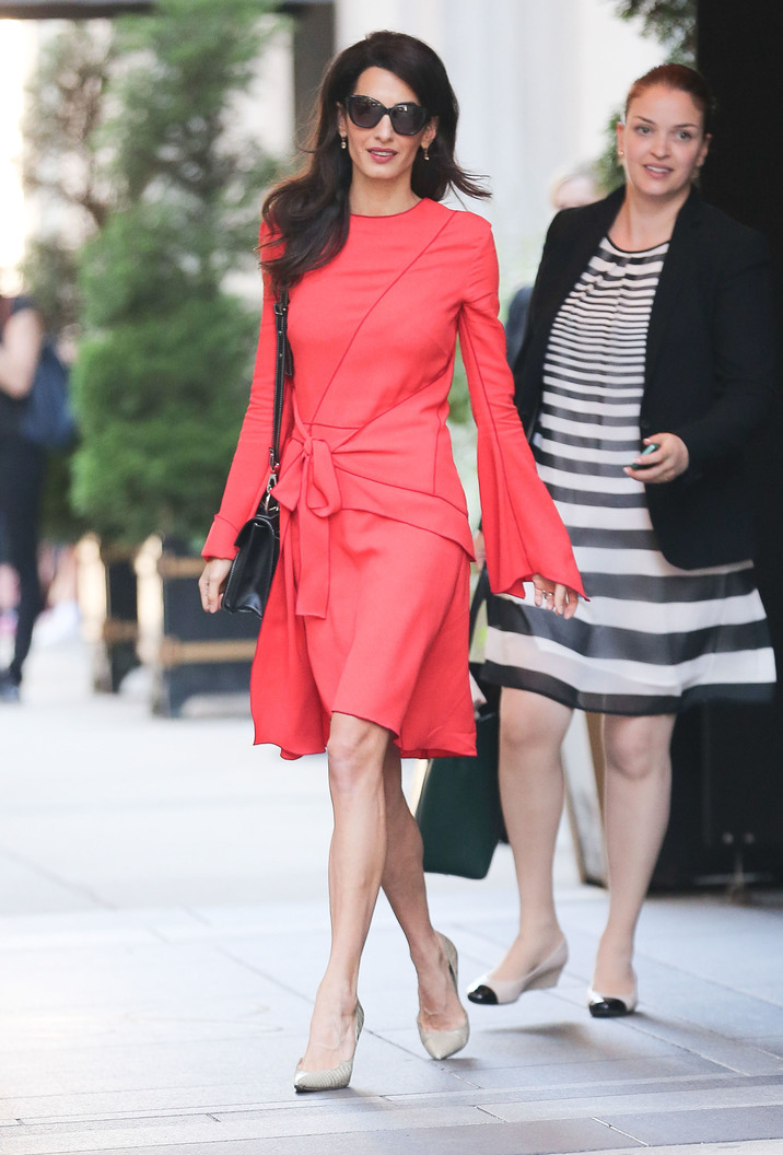 52182671 Layer Amal Clooney steps out wearing a bright pink dress in New York City, New York on September 22, 2016. Amal and her husband, actor George Clooney, will be celebrating their second wedding anniversary on September 27. FameFlynet, Inc - Beverly Hills, CA, USA - +1 (310) 505-9876