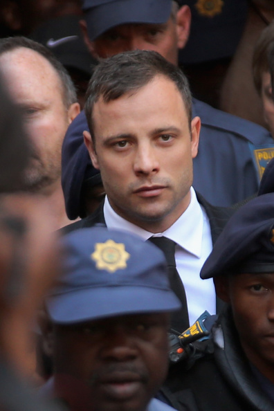 PRETORIA, SOUTH AFRICA - SEPTEMBER 12:  Oscar Pistorius leaves on bail from the North Gauteng High Court on September 12, 2014 in Pretoria, South Africa. South African Judge Thokosile Masipa ruled out murder charges yesterday, but convicted Oscar Pistorius in court today of culpable homicide, as the six month trial of the Olympic double-amputee sprinter comes to an end. His defence maintained that Mr Pistorius mistook Ms Reeva Steenkamp for an intruder in his home when he fired several shots into his bathroom allegedly in self-defence but killing his girlfriend. Sentencing for Pistorius will be on October 13.  (Photo by Christopher Furlong/Getty Images)