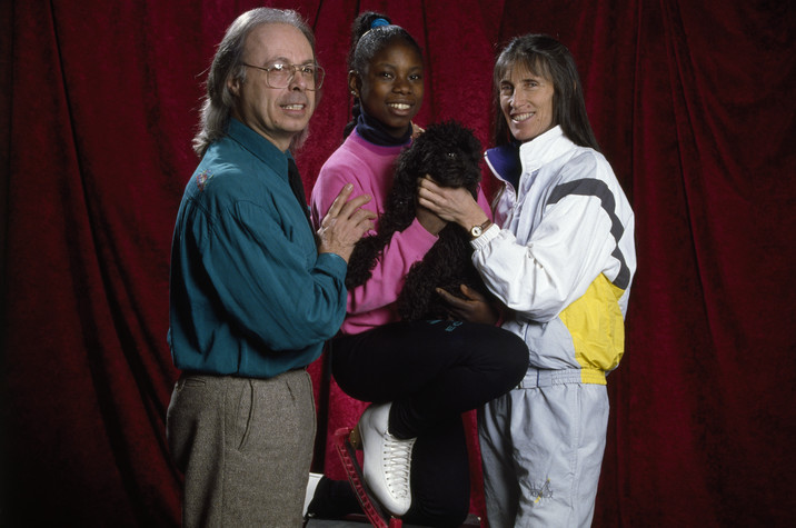 1990s --- French figure skater Surya Bonaly with her parents Georges and Suzanne. --- Image by © Gilbert Iundt; Jean-Yves Ruszniewski/TempSport/Corbis