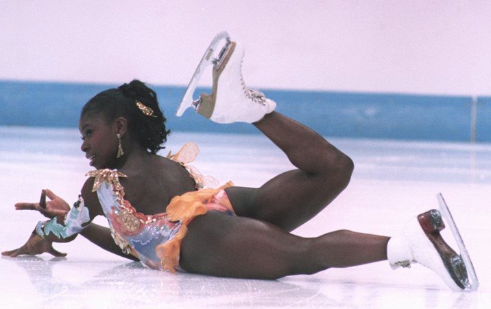 23 FEB 1994:  SURYA BONALY OF FRANCE ENDS HER FIGURE SKATING PROGRAMME AT THE 1994 WINTER OLYMPICS IN LILLEHAMMER.   Mandatory Credit: Chris Cole/ALLSPORT