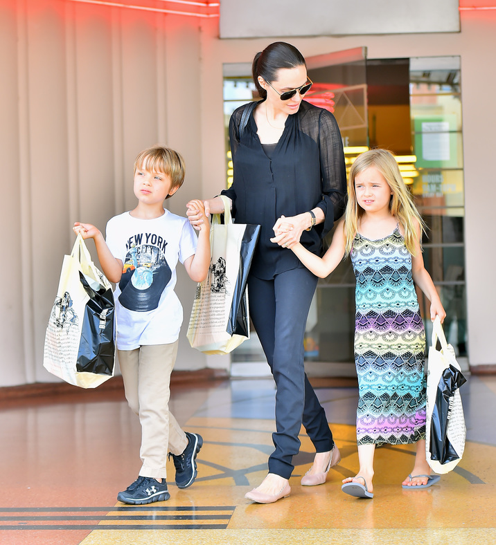 Angelina Jolie takes her children Knox and Vivian to buy their birthday gifts at a bookstore in studio city. Dressed in all black, angie took her twins to a bookstore where she purchased each a tote filled with books for their birthday which was last week Pictured: Angelina Jolie, Vivian Jolie-Pitt, Knox Jolie-Pitt Ref: SPL1082536  190715   Picture by: Fern / Splash News Splash News and Pictures Los Angeles:310-821-2666 New York:212-619-2666 London:870-934-2666 photodesk@splashnews.com