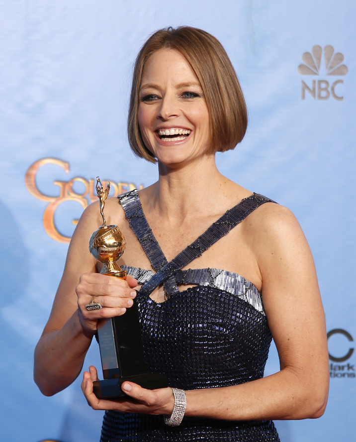 Actress Jodie Foster poses with her Cecil B. DeMille award at the 70th annual Golden Globe Awards in Beverly Hills, California January 13, 2013. REUTERS/Lucy Nicholson (UNITED STATES - Tags: Entertainment) (GOLDENGLOBES-BACKSTAGE)