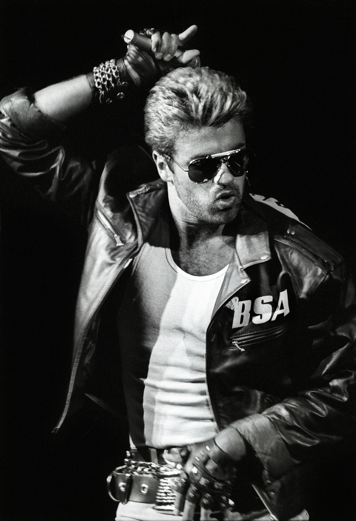 George Michael performs on stage, wearing a leather jacket and sunglasses, on the Faith Tour, at Ahoy, Rotterdam, Netherlands, 12th April 1988. (Photo by Rob Verhorst/Redferns)