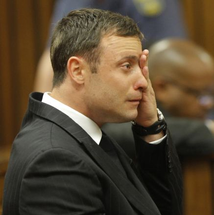PRETORIA, SOUTH AFRICA - SEPTEMBER 11:  (BY COURT ORDER, THIS IMAGE IS FREE TO USE) Oscar Pistorius sits in the Pretoria High Court on September 11, 2014, in Pretoria, South Africa. South African Judge Thokosile Masipa is due to give her verdict as the six month trial of Olympic double-amputee sprinter Oscar Pistorius comes to an end today. His defence maintained that Mr Pistorius mistook Ms Reeva Steenkamp for an intruder in his home when he fired several shots into his bathroom allegedly in self-defence but killing his girlfriend. (Photo  Kim Ludbrook/ - Pool/EPA/Gallo Image/Getty Images)