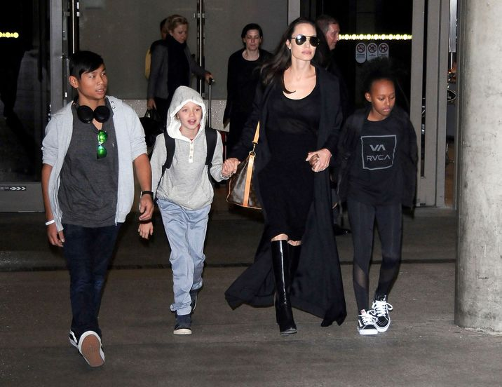 51985743 Actress Angelina Jolie and her kids Pax, Shiloh and Zahara are seen arriving on a flight at LAX airport in Los Angeles, California on March 2, 2016. The family was returning from Cambodia where Angelina spent the last 3 months filming the documentary 'First They Killed My Father'. FameFlynet, Inc - Beverly Hills, CA, USA - +1 (310) 505-9876