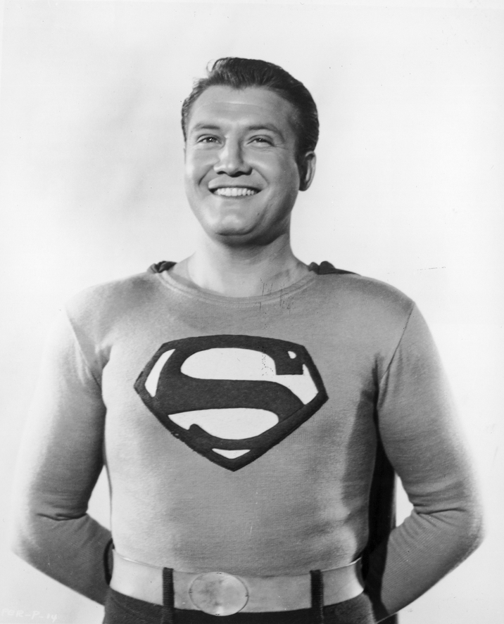 1953:  American actor George Reeves smiling in costume as Superman in a promotional portrait for the television series, 'Adventures of Superman'.  (Photo by Hulton Archive/Getty Images)