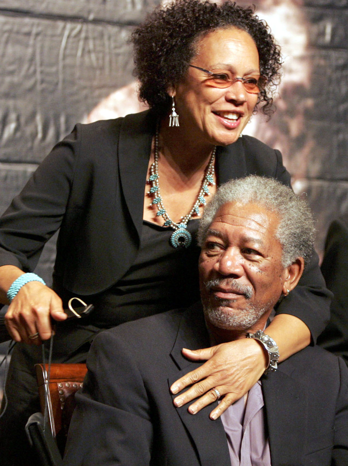 "SHANGHAI, CHINA - JUNE 18: (CHINA OUT; PHOTOCOME OUT) US actor Morgan Freeman and his wife pose for pictures at a press conference to promote movie ""Batman Begins"" at the 8th Shanghai International Film Festival on June 18, 2005 in Shanghai, China. (Photo by China Photos/Getty Images)"