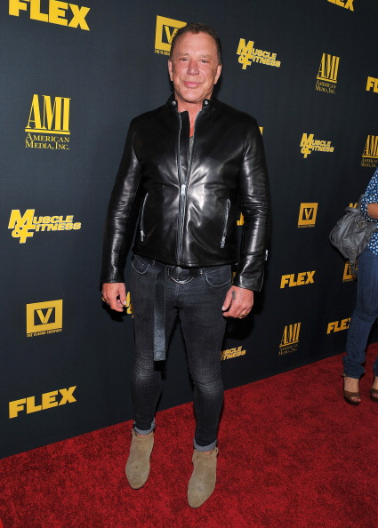 HOLLYWOOD, CA - SEPTEMBER 18:  Actor Mickey Rourke arrives at the Los Angeles premiere of 'GENERATION IRON'  at Chinese 6 Theater Hollywood on September 18, 2013 in Hollywood, California.  (Photo by Angela Weiss/Getty Images)