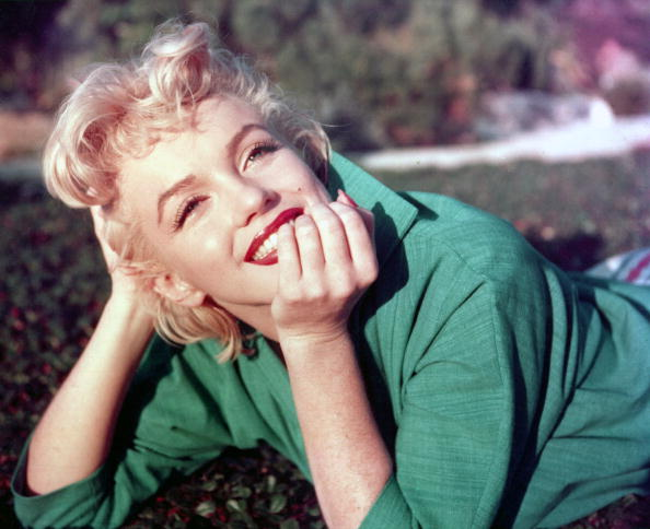 PALM SPRINGS, CA - 1954: Actress Marilyn Monroe poses for a portrait laying on the grass in 1954 in Palm Springs, California. (Photo by Baron/Getty Images)