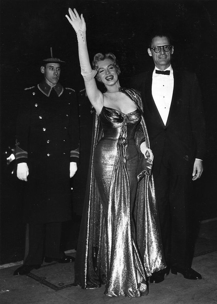 October 1956:  American film actress Marilyn Monroe (1926 - 1962) with her husband, American playwright Arthur Miller, at the Royal Film Performance at The Empire, Leicester Square, London.  (Photo by Topical Press Agency/Getty Images)