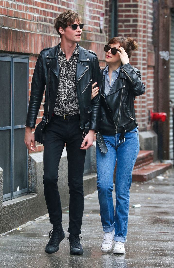 52044142 Couple Dakota Johnson and Matthew Hitt are spotted out for a stroll on a rainy day in New York City, New York on May 3, 2016. The pair were wearing matching black leather jackets. FameFlynet, Inc - Beverly Hills, CA, USA - +1 (310) 505-9876