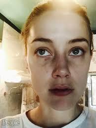 Amber, lovită de Johnny Depp