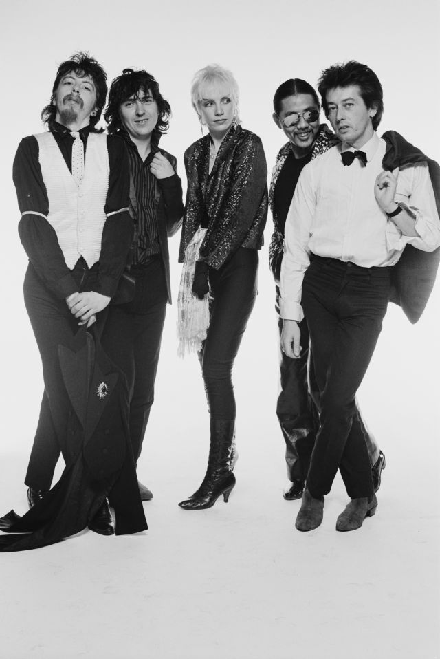 The Tourists (guitarist Dave Stewart, singer and guitarist Peet Coombes (1952–1997), singer and keyboard player Annie Lennox, bassist Eddie Chin, and drummer Jim Toomey), British pop group, pose for a group studio portrait against a white background, United Kingdom, in April 1979. (Photo by Fin Costello/Redferns/Getty Images)