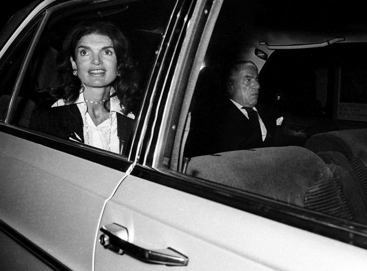 Jackie Kennedy Onassis and Aristotle Onassis in car after leaving 'Le Coq Hardi' restaurant in , france, october 2, 1973. (Photo by RDA/Getty Images)
