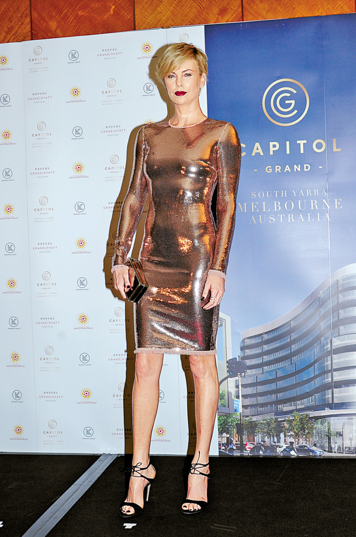South African-American actress Charlize Theron poses as she arrives for a promotional event for Australia's first six-star residential and luxury retail precinct Capitol Grand tower as the brand ambassador in Hong Kong, China, 28 October 2015. Ref: SPL1164067 281015 Picture by: Imaginechina / Splash News Splash News and Pictures Los Angeles:310-821-2666 New York: 212-619-2666 London: 870-934-2666 photodesk@splashnews.com
