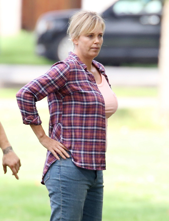 52186006 Actress Charlize Theron is spotted set of 'Tully' in Vancouver, Canada on September 26, 2016. The film is about Marlo, a mother of three including a newborn, who is gifted a night nanny by her brother. Hesitant to the extravagance at first, Marlo comes to form a unique bond with the thoughtful, surprising and sometimes challenging young nanny named Tully. FameFlynet, Inc - Beverly Hills, CA, USA - +1 (310) 505-9876