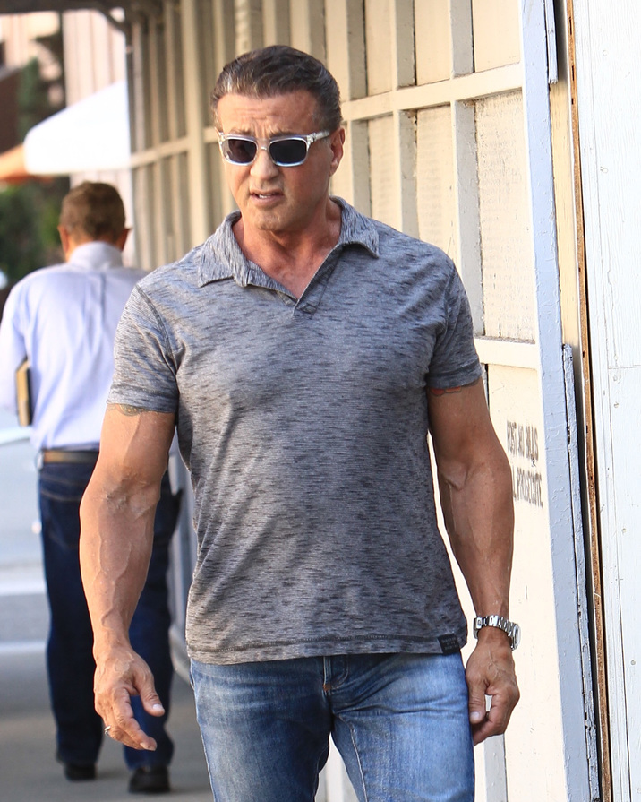 52196668 Actor Sylvester Stallone poses for a selfie with a fan while he was out and about in Beverly Hills, California on October 6, 2016. Afterwards, he stood by a man and waited outside before continuing his day. FameFlynet, Inc - Beverly Hills, CA, USA - +1 (310) 505-9876