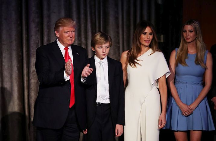 NEW YORK, NY - NOVEMBER 09: (L-R) Republican president-elect Donald Trump, his son Barron Trump, wife Melania Trump, and daughter Ivanka Trump acknowledges the crowd along with his son Barron Trump during his election night event at the New York Hilton Midtown in the early morning hours of November 9, 2016 in New York City. Donald Trump defeated Democratic presidential nominee Hillary Clinton to become the 45th president of the United States. (Photo by Mark Wilson/Getty Images)