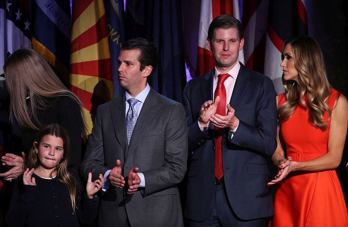 NEW YORK, NY - NOVEMBER 09: (L-R) Donald Trump Jr., Eric Trump and his wife Lara Yunaska stand on stage and acknowledge the crowd during Donald Trumps election night event at the New York Hilton Midtown in the early morning hours of November 9, 2016 in New York City. Donald Trump defeated Democratic presidential nominee Hillary Clinton to become the 45th president of the United States. (Photo by Mark Wilson/Getty Images)