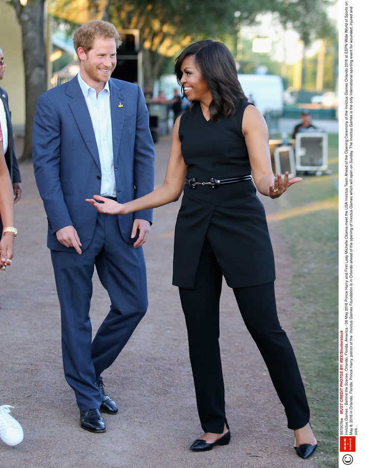 Mandatory Credit: Photo by REX/Shutterstock (5679074w) Prince Harry and First Lady Michelle Obama meet the USA Invictus Team Invictus Games - Behind the Scenes, Orlando, Florida, America - 08 May 2016 Ahead of the Opening Ceremony of the Invictus Games Orlando 2016 at ESPN Wide World of Sports on May 8, 2016 in Orlando, Florida. Prince Harry, patron of the  Invictus Games Foundation is in Orlando ahead of the opening of Invictus Games which will open on Sunday. The Invictus Games is the only International sporting event for wounded, injured and sick servicemen and women. Started in 2014 by Prince Harry the Invictus Games uses the power of Sport to inspire recovery and support rehabilitation