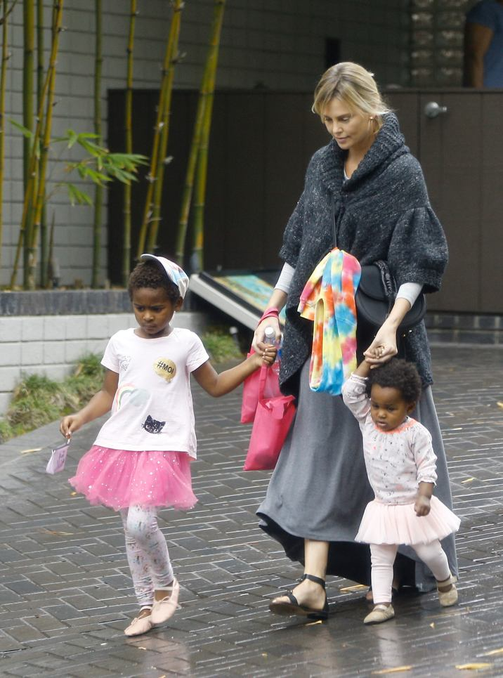 52218662 Actress Charlize Theron takes her two kids Jackson Theron and August Theron to a birthday party in Beverly Hills, California on October 30, 2016.  Both of her kids wore pink tutus and appeared to be dressed like ballerinas in light of Halloween. August had long blonde hair pinned to his hair. FameFlynet, Inc - Beverly Hills, CA, USA - +1 (310) 505-9876