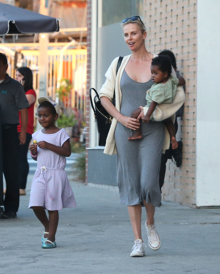 Exclusive... 52113423 Actress Charlize Theron and a friend take her kids Jackson and August out for lunch in Hollywood, California on July 5, 2016. Charlize took a break from lunch to go outside and FaceTime an unknown male, could it be Tyrese Gibson who claimed to have gotten her number after flirting on the set of 'Fast 8'? She could be seen giving the phone kisses and giving the guy a middle finger. Charlize continued to support her son's choice of dressing like a Disney Princess as Jackson could be seen wearing a grey dress and a blonde wig like the character from 'Frozen'. ***NO USE W/O PRIOR AGREEMENT-CALL FOR PRICING*** FameFlynet, Inc - Beverly Hills, CA, USA - +1 (310) 505-9876