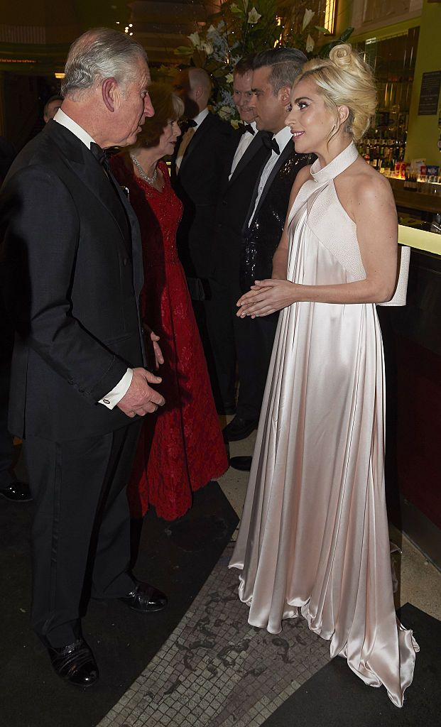 LONDON, ENGLAND - DECEMBER 06:  Prince Charles, Prince of Wales and Camilla, Duchess of Cornwall greet Robbie Williams and Lady Gaga during the Royal Variety Performance at Eventim Apollo on December 6, 2016 in London, England.  (Photo by Niklas Halle'n- WPA Pool/Getty Images)