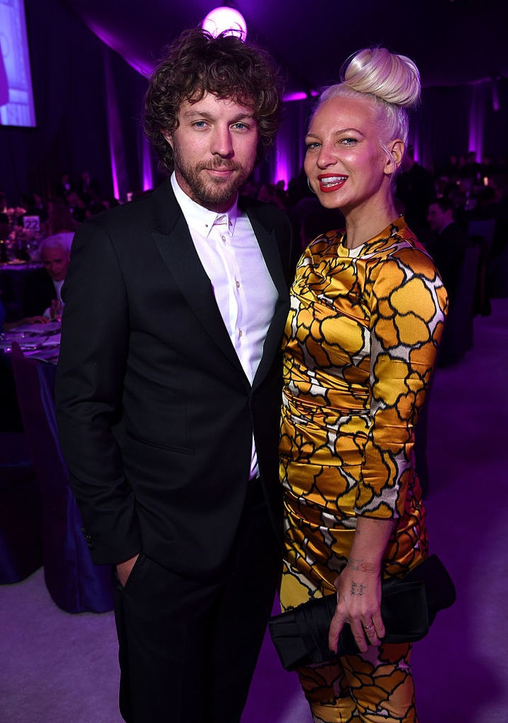 LOS ANGELES, CA - FEBRUARY 22: Filmmaker Erik Anders Lang (L) and singer/songwriter Sia attend the 23rd Annual Elton John AIDS Foundation Academy Awards Viewing Party on February 22, 2015 in Los Angeles, California. (Photo by Dimitrios Kambouris/Getty Images for EJAF)