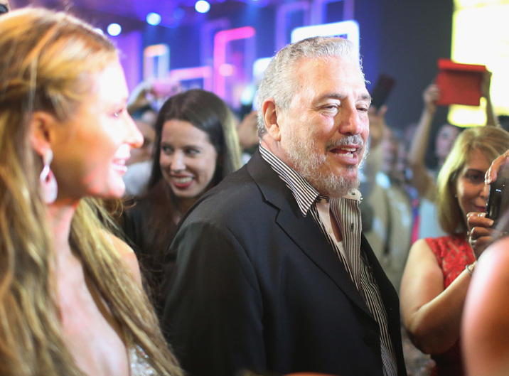 HAVANA, CUBA - FEBRUARY 27:  Fidel 'Fidelito' Castro Diaz-Balart, son of Cuban revoloutionary leader Fidel Castro, stands near Paris Hilton (L) as they attend the closing gala night for the week-long International Habano Cigar Festival on February 27, 2015 in Havana, Cuba. The annual cigar festival attracted tourists from around the world to sample the islands world renowned tobacco.  (Photo by Joe Raedle/Getty Images)