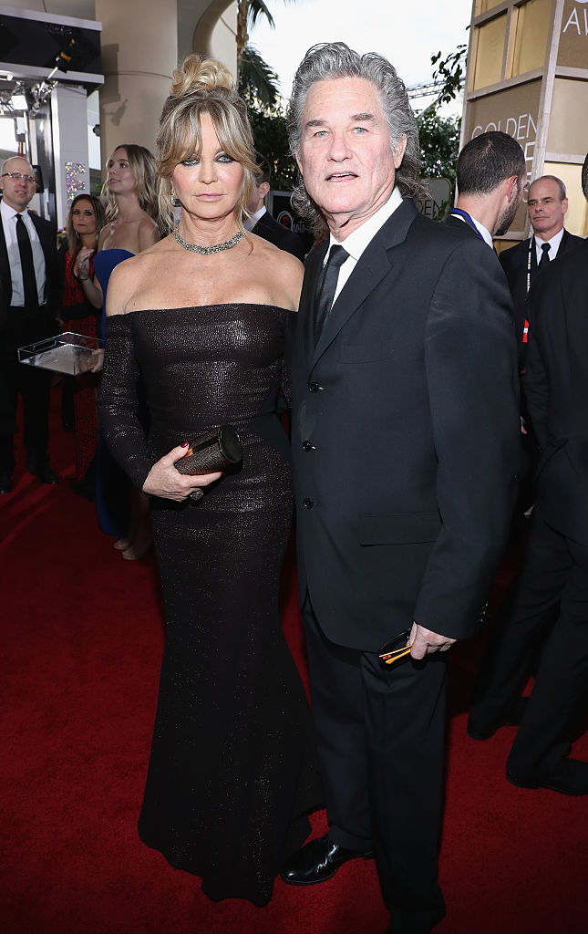 BEVERLY HILLS, CA - JANUARY 08: Actors Goldie Hawn (L) and Kurt Russell at the 74th annual Golden Globe Awards sponsored by FIJI Water at The Beverly Hilton Hotel on January 8, 2017 in Beverly Hills, California. (Photo by Jonathan Leibson/Getty Images for FIJI Water)