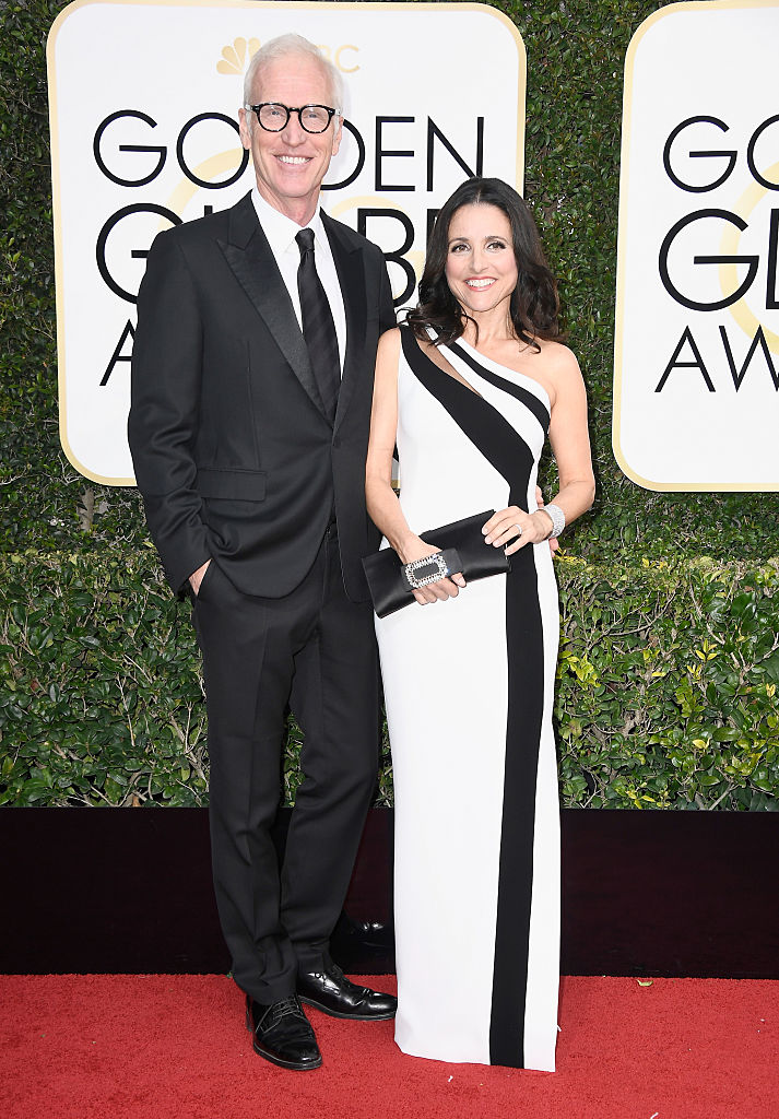BEVERLY HILLS, CA - JANUARY 08: Actress Julia Louis-Dreyfus (R) and Brad Hall attend the 74th Annual Golden Globe Awards at The Beverly Hilton Hotel on January 8, 2017 in Beverly Hills, California. (Photo by Frazer Harrison/Getty Images)
