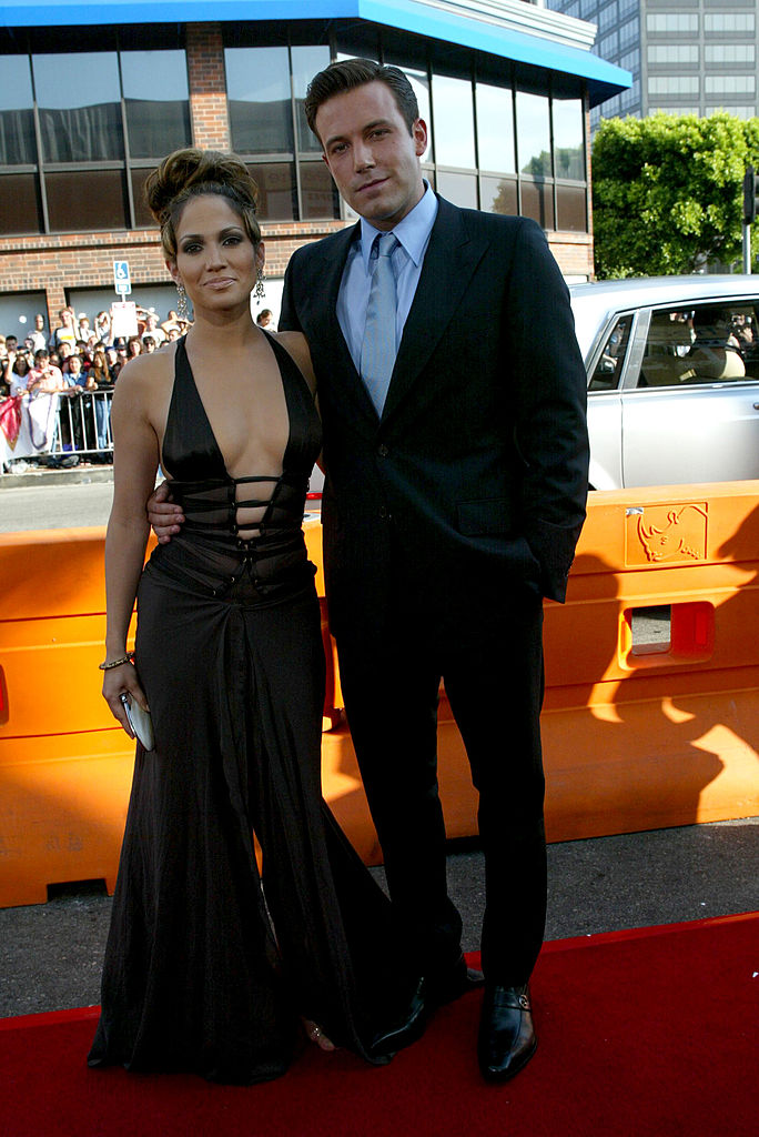 """WESTWOOD, CA - JULY 27: Actors Ben Affleck and Jennifer Lopez attend the premiere of Revolution Studios' and Columbia Pictures' film """"Gigli"""" at the Mann National Theatre July 27, 2003 in Westwood, California. """"Gigli"""" opens nationwide on August 1, 2003. (Photo by Frederick M. Brown/Getty Images)"""