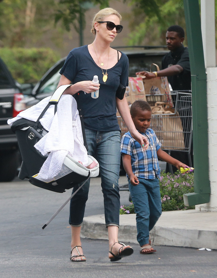 Exclusive... 51847942 Actress Charlize Theron out grocery shopping at Bristol Farms with her kids Jackson and August in Hollywood, California on September 12, 2015. Charlize just adopted August, after splitting from Sean Penn. FameFlynet, Inc - Beverly Hills, CA, USA - +1 (818) 307-4813