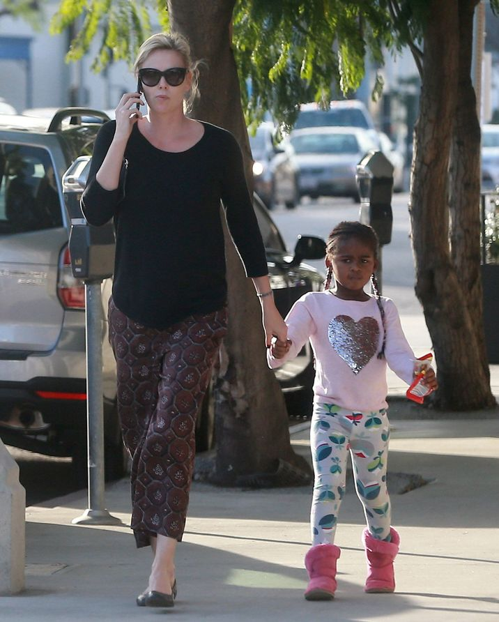 Exclusive... 52284921 Actress and busy mom Charlize Theron was spotted stopping by a gas station with her son Jackson while out running errands in Los Angeles, California on January 17, 2017. Charlize continues to dress her son in girl's clothing including a pink shirt with a silver heart, braids in his hair, and even a disney princess backpack. FameFlynet, Inc - Beverly Hills, CA, USA - +1 (310) 505-9876