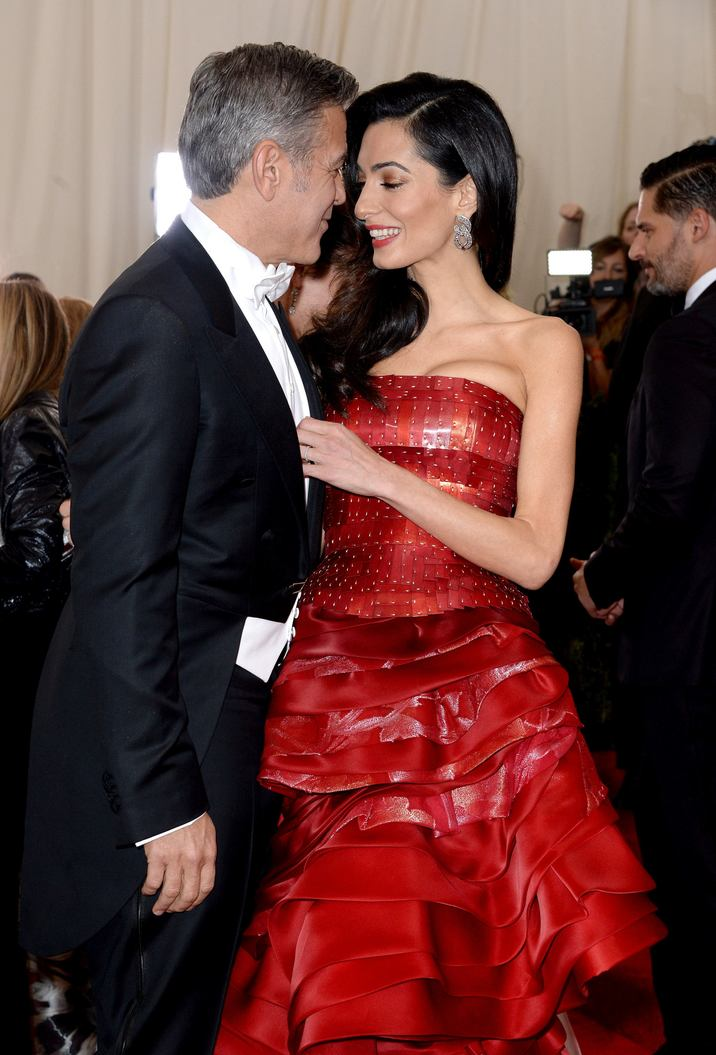 """File photo : Amal Clooney and George Clooney attend the China: Through The Looking Glass Costume Institute Benefit Gala at Metropolitan Museum of Art on May 4, 2015 in New York City, NY, USA. Amal Clooney and her husband George are expecting twins, US media report. The babies are due in June, according to CBS's The Talk host Julie Chen. Another source close to the couple, quoted by People, said they were """"very happy"""". The Clooneys' representatives have not yet commented. Photo by Lionel Hahn/ABACAPRESS.COM"""