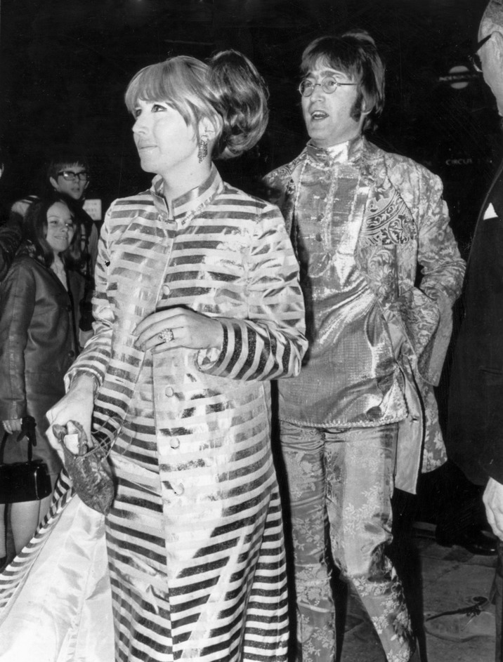 UNITED KINGDOM  :  Caption reads: 'How to stop the traffic - John and Cynthia Lennon last night'. John Lennon (1940-1980) formed the Beatles in 1960 with Paul McCartney (1942-), George Harrison (1943-2001) and Ringo Starr (1940-) in Liverpool, England. They went on to become the most successful pop group of all time and finally split in 1970. Lennon married his first wife Cynthia Powell (1939-) in 1962 and they had one child together, Julian (1963-). Following his divorce from Cynthia in 1968 John Lennon married the Japanese avant-garde artist Yoko Ono in March 1969. Lennon was murdered on 8 December 1980 in New York by Mark Chapman.  (Photo by SSPL/Getty Images)