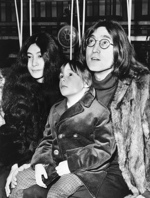 """(Original Caption) 12/19/1968-London, England- John Lennon, a member of the Beatles, was entertained by another singing group 12/10 when he took his five-year-son, Julian, to the rehearsals of the """"Rolling Stones Rock 'n' Roll Circus Show."""" Also accompanying Lennon was artist Yoko Onon (l). The show is scheduled to be a London television spectacular produced by the Rolling Stones."""
