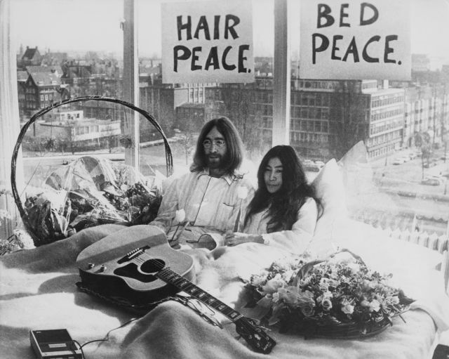 Beatle John Lennon (1940 ? 1980) and his wife of a week Yoko Ono in their bed in the Presidential Suite of the Hilton Hotel, Amsterdam, 25th March 1969. The couple are staging a 'bed-in for peace' and intend to stay in bed for seven days 'as a protest against war and violence in the world'. (Photo by Keystone/Hulton Archive/Getty Images)