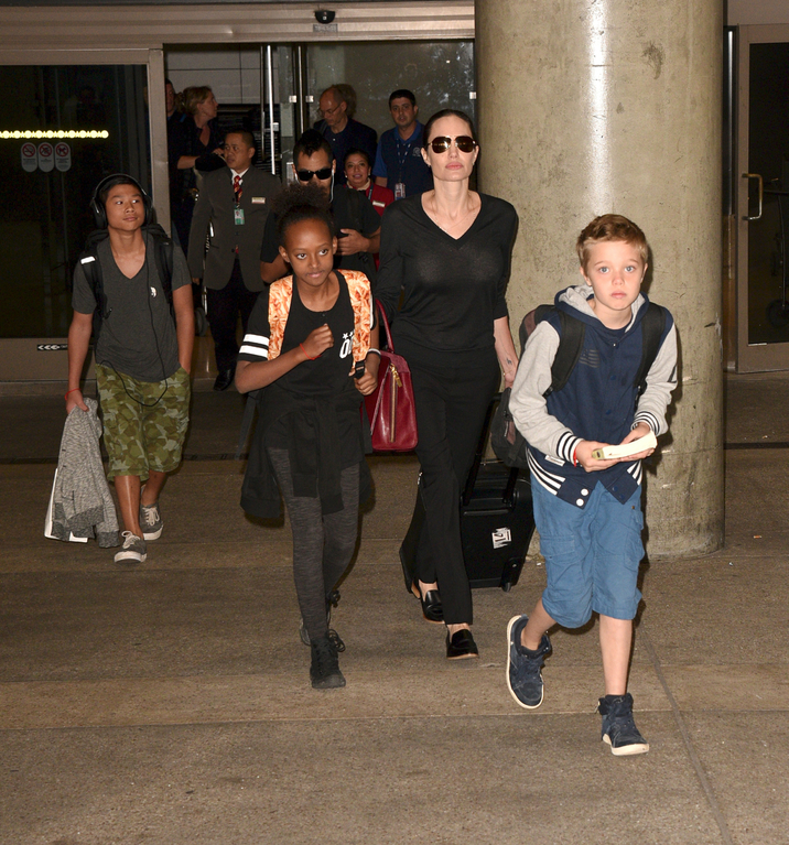 Angelina Jolie arrives at LAX airport with her kids - Maddox, Pax, Zahara and Shiloh. Pictured: Angelina Jolie, Kids Ref: SPL1162834  271015   Picture by: MONEY$HOT / Splash News Splash News and Pictures Los Angeles:310-821-2666 New York:212-619-2666 London:870-934-2666 photodesk@splashnews.com