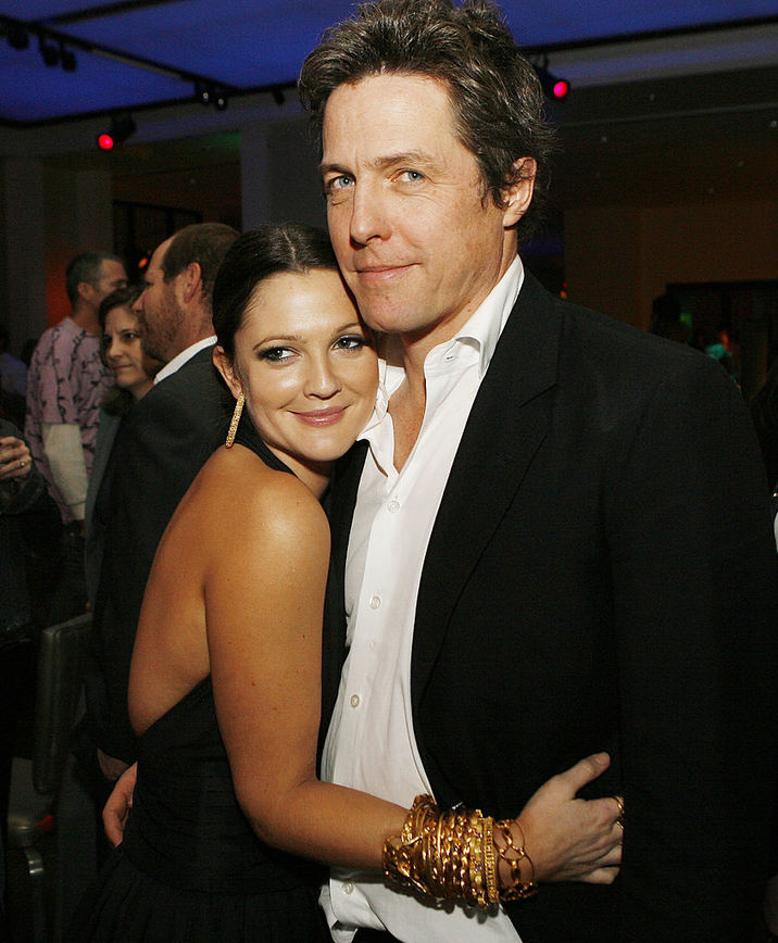 "LOS ANGELES - FEBRUARY 7: Actors Drew Barrymore and Hugh Grant pose at the afterparty for the premiere of Warner Bros. Picture's ""Music and Lyrics"" at the Annix on February 7, 2007 in Los Angeles, California. (Photo by Kevin Winter/Getty Images)"