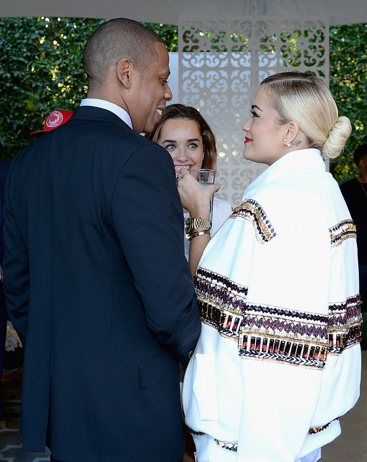 BEVERLY HILLS, CA - JANUARY 25: (Exclusive Coverage) Rapper/producer Jay-Z (L) and recording artist Rita Ora attend the Roc Nation Pre-GRAMMY Brunch Presented by MAC Viva Glam at Private Residence on January 25, 2014 in Beverly Hills, California. (Photo by Larry Busacca/Getty Images)