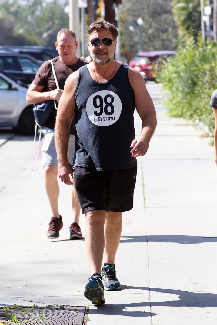 Russell Crowe goes for a run with a mystery blonde around Beverly Hills. Pictured: Russell Crowe Ref: SPL1237015 270216 Picture by: LA Photo Lab / Splash News Splash News and Pictures Los Angeles: 310-821-2666 New York: 212-619-2666 London: 870-934-2666 photodesk@splashnews.com